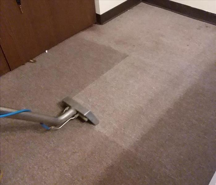 Extracting water out of the carpet.